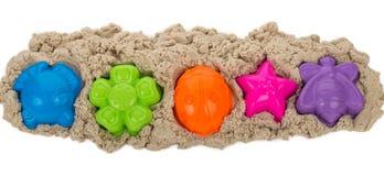 Kinetisk sand med mångfärgade former Royaltyfri Bild