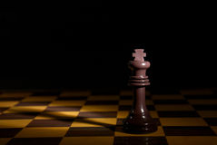 King. The queeen has the king at her feet on the chessboard, female power Royalty Free Stock Photography