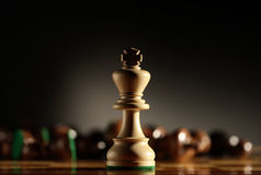King. Chess piece with others in background. Low depth of field, focus on foreground Stock Images
