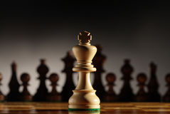 King. Chess piece with others in background. Low depth of field, focus on foreground stock photography