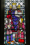 King Alfred Window, Winchester. Historic stained glass window at St Bartholomew's Church in Winchester, Hampshire commemorating the great English King Alfred Stock Photography