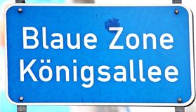 King Avenue. Blue road sign in Duesseldorf, Germany Stock Photography