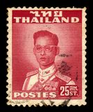 King Bhumibol Adulyadej, King of Thailand. Thailand - CIRCA 1961: A stamp printed in Thailand shows King Bhumibol Adulyadej, King of Thailand King Rama IX royalty free stock images