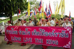 King Birthday Celebration, Thailand. Chiang Mai, Thailand - December 3, 2012: Young women holding a banner at the front of a parade to celebrate the King's Stock Photos