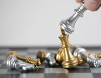 King blond kick the King Gold to victory for this game. Chess board is the intelligence strategy game to make ideas for business and marketing concept, the stock photo