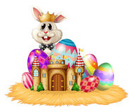 A king bunny with easter eggs Royalty Free Stock Images