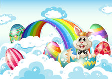 A king bunny at the sky with Easter eggs Royalty Free Stock Photography