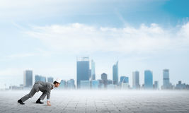 King businessman in elegant suit running and business center at background Royalty Free Stock Image