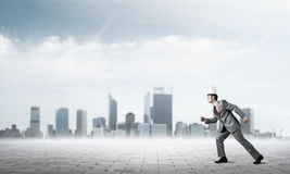 King businessman in elegant suit running and business center at Royalty Free Stock Images