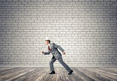King businessman in elegant suit running in empty room royalty free stock photo