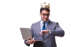The king businessman holding a laptop isolated on white background Stock Photo