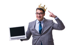 The king businessman holding a laptop isolated on white background Royalty Free Stock Images