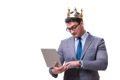 The king businessman holding a laptop isolated on white background Royalty Free Stock Image