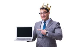 The king businessman holding a laptop isolated on white background. King businessman holding a laptop isolated on white background Royalty Free Stock Photos