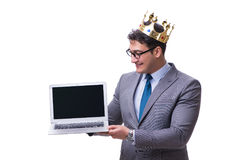 The king businessman holding a laptop isolated on white background Stock Image