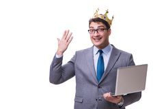 The king businessman holding a laptop isolated on white background. King businessman holding a laptop isolated on white background Stock Photo