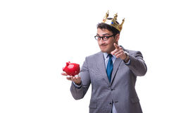 King businessman holding a piggy bank isolated on white backgrou Stock Photography