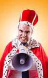 King businessman with loudspeaker isolated on Royalty Free Stock Photos