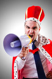 King businessman with loudspeaker  Stock Images