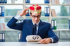 The king businessman with money sack in office. King businessman with money sack in office royalty free stock image