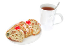 King cake slices close-up on a plate with a cup of tea. Royalty Free Stock Photos
