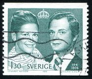 King Carl XVI Gustaf and Queen Silvia. Sweden - CIRCA 1976: stamp printed by Sweden, shows King Carl XVI Gustaf and Queen Silvia, circa 1976 Stock Photo