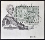 King Charles III and a view of the Puerta de Alcal. SPAIN - CIRCA 1988: A stamp printed in Spain shows King Charles III and a view of the Puerta de Alcala in stock image
