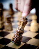 King chess figure falls. Human finger crashes down king chess piece Stock Photography