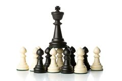 King chess figure on top of pawn chess figures. King chess figure standing on top of pawn chess figures - management, leadership, teamlead or strategy concept Stock Photo