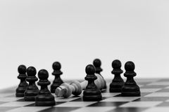 King in chess has fallen to several pawns Royalty Free Stock Images