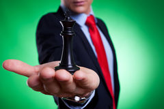 King of chess in the palm of a young business man Stock Image