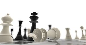A king chess piece defeating another. With background blur Stock Photo