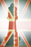 King Chess Piece in front of union jack Royalty Free Stock Image
