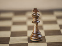 King Chess Piece on Game Board Stock Photos