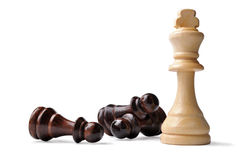 King chess piece with opposition pawns Royalty Free Stock Photography