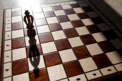King chess piece with others in background Royalty Free Stock Photo