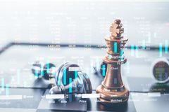 He king chess piece with chess others nearby go down from floating board game concept of business ideas. Investment Leadership Concept : The king chess piece stock photo