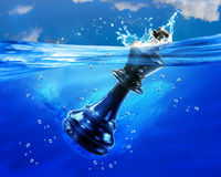King Chessman in Water. Kink Chessman in deep blue water Royalty Free Stock Photos