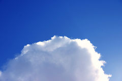 King of the clouds. Cloud against blue sky stock photography
