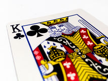 King Clovers / Clubs Card with White Background. A playing card is a piece of specially prepared heavy paper, thin cardboard, plastic-coated paper, cotton-paper Stock Photography