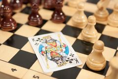 King of clubs. The king of clubs on Chess board Royalty Free Stock Photography