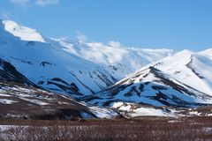 King Cove Alaska. King Cove Agdaaĝux in Aleut is a city in Aleutians East Borough, Alaska, United States. Mountain view along King Cove Road royalty free stock images