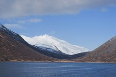King Cove Alaska. King Cove Agdaaĝux in Aleut is a city in Aleutians East Borough, Alaska, United States. Mountain view along King Cove Road stock images