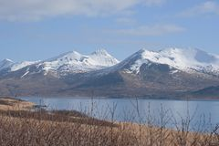 King Cove Alaska. King Cove Agdaaĝux in Aleut is a city in Aleutians East Borough, Alaska, United States. Harbor view of King Cove with mountains stock images