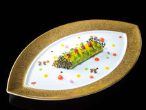 King crab and avocado cannelloni citrus and vanilla on oval plat Stock Images