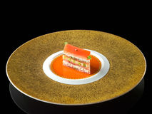 King crab and tomato mille feuille with a coulis verjute Royalty Free Stock Image