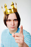King with crown shows his finger Stock Photo