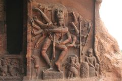 King of Dance, Nataraja. Lord Shiva (Nataraja) in dancing pose with 18 hands depicting various poses (Mudras) at entrance of Cave I in Badami Stock Photos