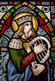 King David. Detail of victorian stained glass church window in Fringford depicting King David, the author fo the psalms in the Old testament with a hand harp stock photos
