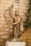 King David's statue playing the harp Stock Photos